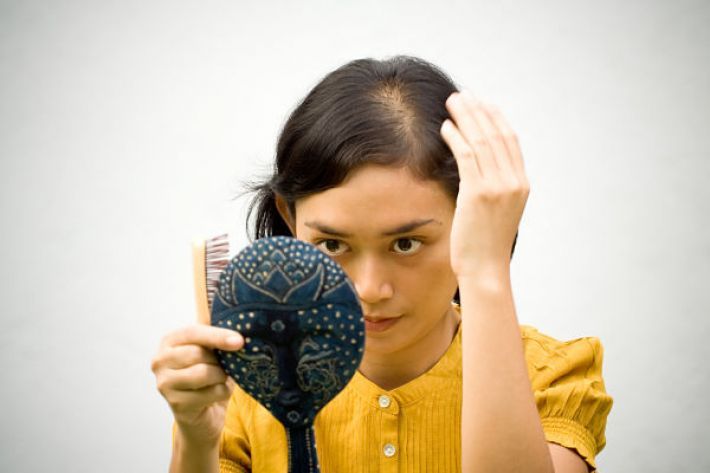 Can thyroid disease cause hair loss
